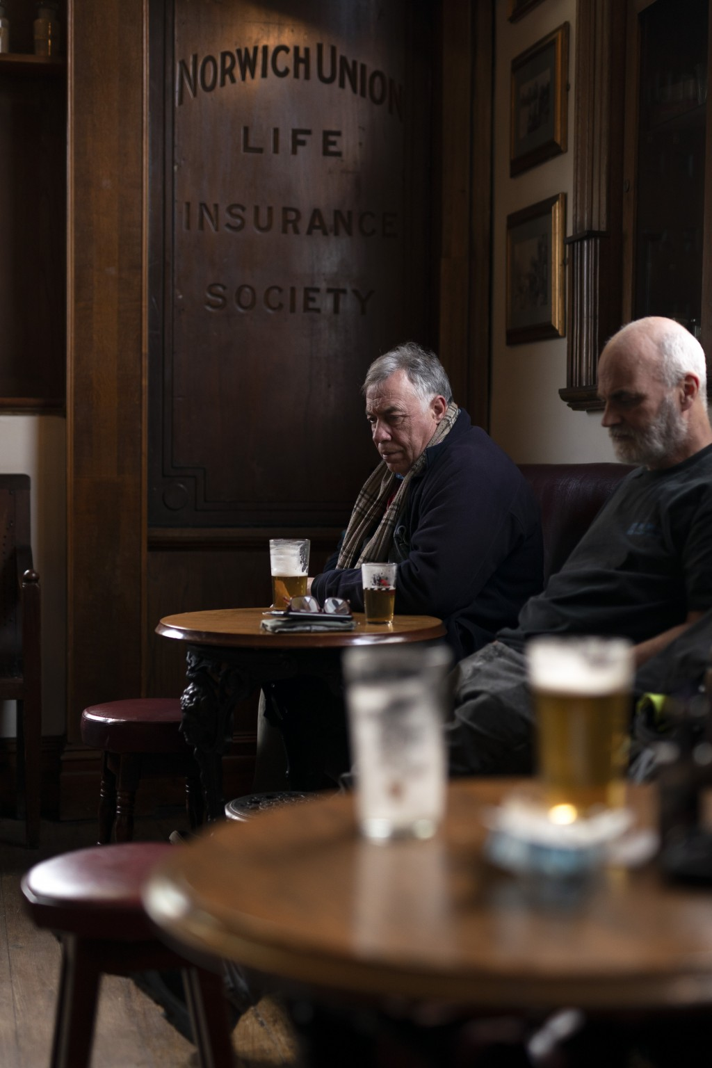 Men drink at the Dispensary pub in Liverpool, England, Monday Oct 12, 2020. As the first area in England slapped with strict new restrictions to curb ...