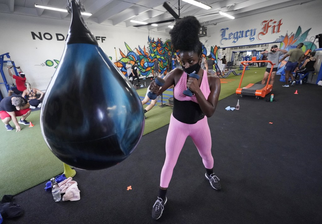 Torya Whittaker works out, Monday, Aug. 31, 2020, at Legacy Fit in the Wynwood Art District of Miami. As the vast majority of in-person fitness clubs ...
