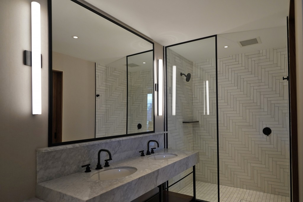 A new bathroom is shown at the Hotel Haya Monday, Aug. 31, 2020, in Tampa, Fla. When the pandemic hit, the Aparium group was deep into construction on...