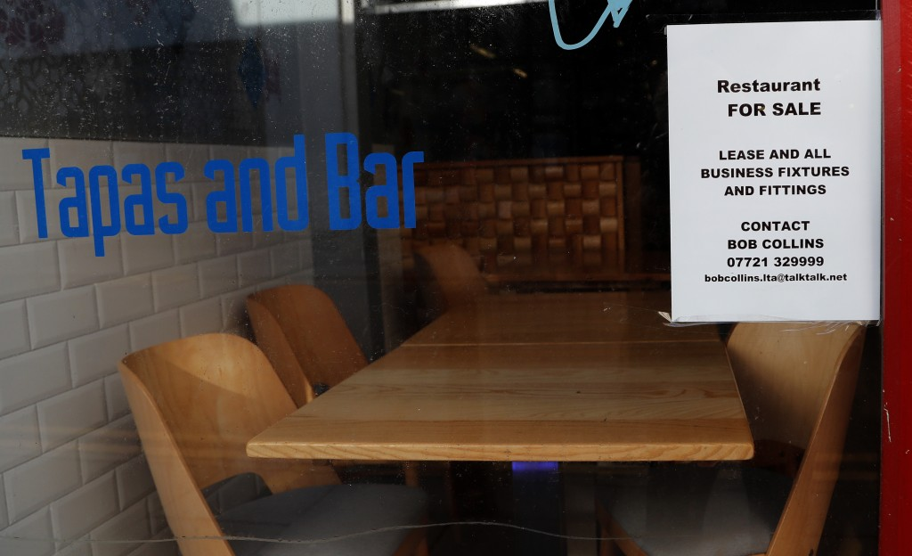 A 'For Sale' sign is placed in the window of a former restaurant in Liverpool, England, Wednesday, Oct. 14, 2020. As the first area in England slapped...