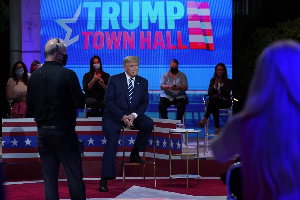 President Donald Trump sits during a break in an NBC News Town Hall, at Perez Art Museum Miami, Thursday, Oct. 15, 2020, in Miami. (AP Photo/Evan Vucc...