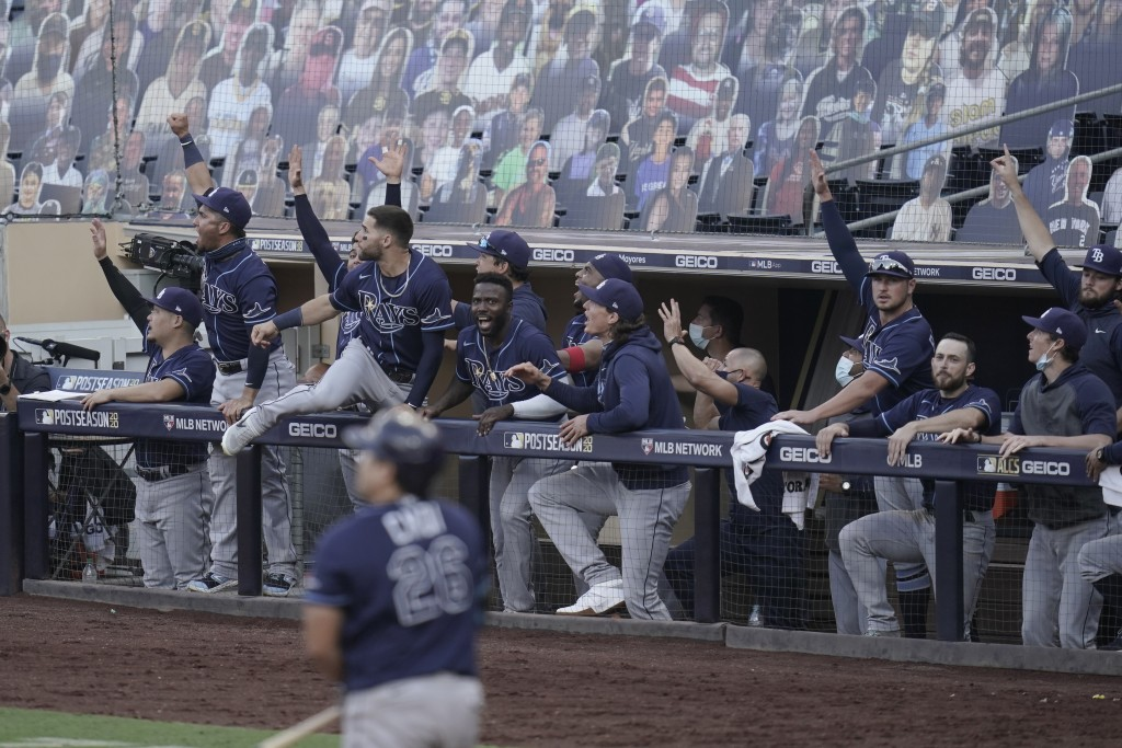 Tampa Bay players react to Rays' Ji-Man Choi home run against the Houston Astros during the seventh inning in Game 5 of a baseball American League Cha...