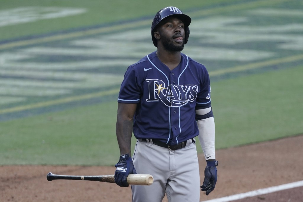 Tampa Bay Rays Randy Arozarena reacts to a strike call during the seventh inning in Game 5 of a baseball American League Championship Series against t...