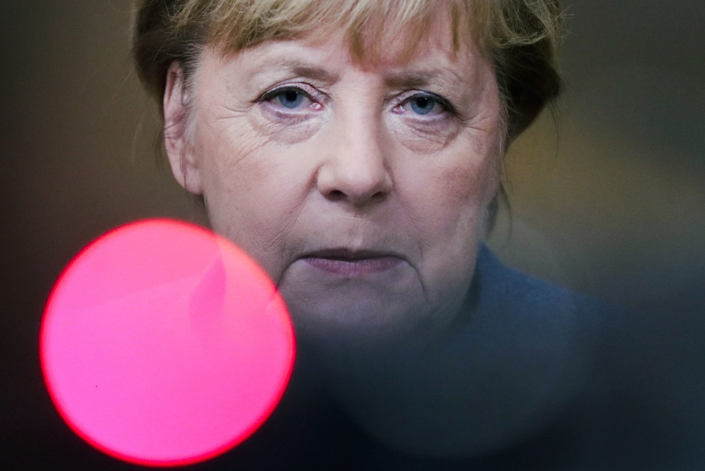 German Chancellor Angela Merkel speaks to the media during departures at an EU summit in Brussels, Thursday, Oct. 15, 2020. European Union leaders met...