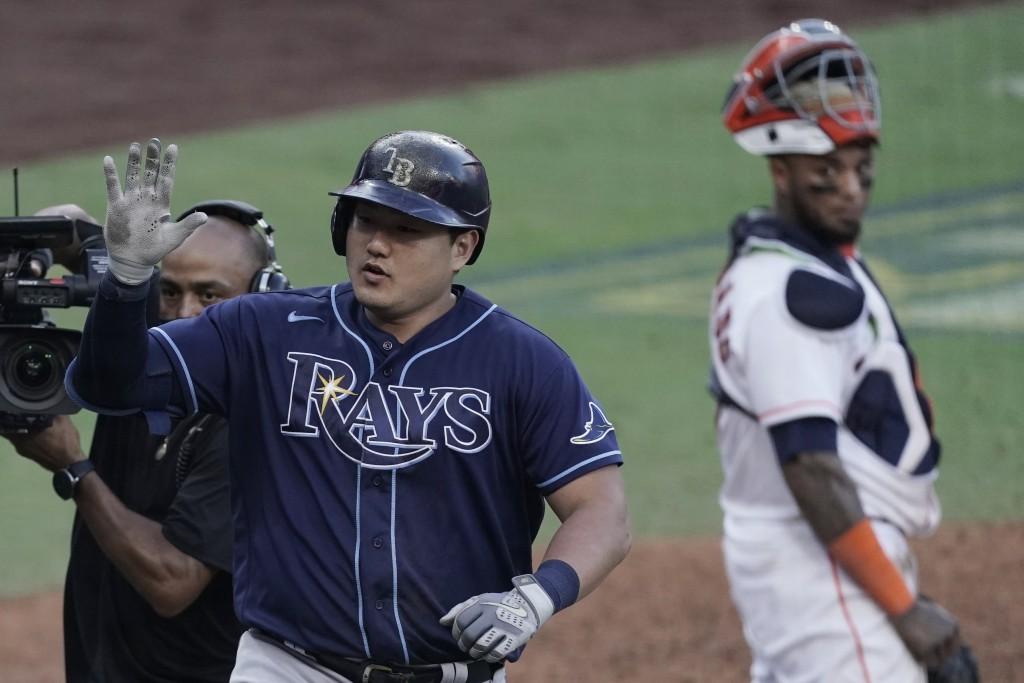 Houston Astros catcher Martin Maldonado looks back as Tampa Bay Rays' Ji-Man Choi celebrates home run during the seventh inning in Game 5 of a basebal...