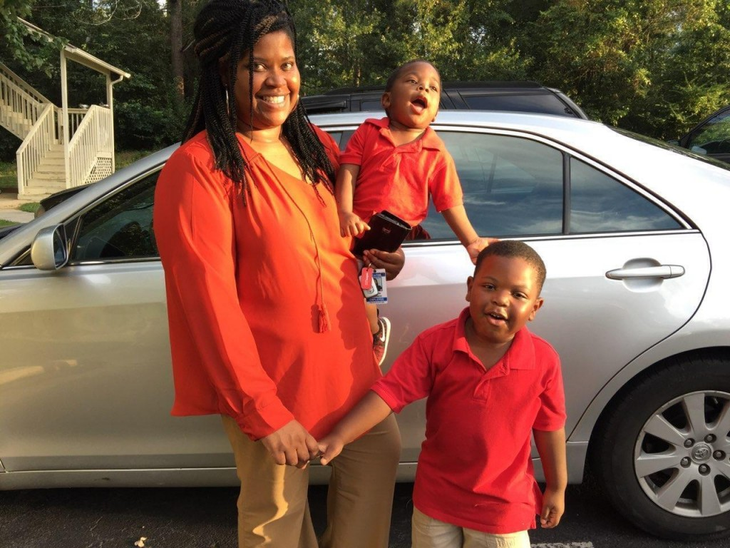In this 2017 photo provided by her family, Saferia Johnson, of Thomasville, Ga., holds her sons, Kyrei, center, and Josiah. Johnson earned a reputatio...