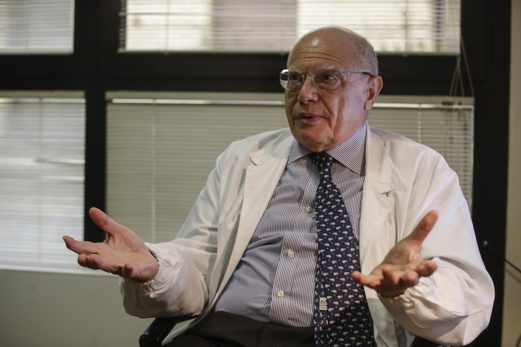 Virologist Massimo Galli, director of the Sacco hospital in Milan, answers questions during an interview with the Associated Press, at the Sacco hospi...