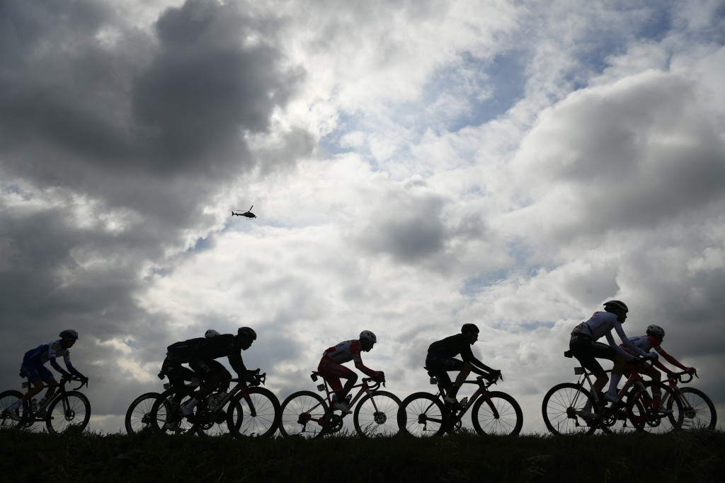 Cyclists pedal during the 13th stage of the Giro d'Italia, tour of Italy cycling race, from Cervia to Monselice, Italy, Friday, Oct. 16, 2020. (Fabio ...