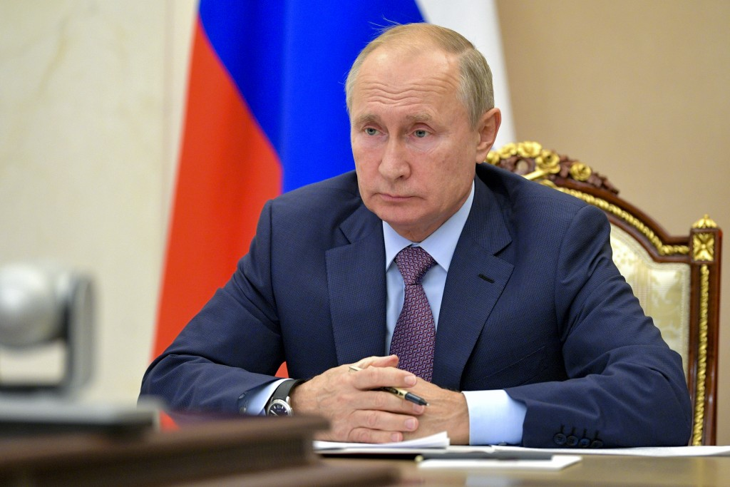 Russian President Vladimir Putin chairs a Security Council meeting via video conference in Moscow, Russia, Wednesday, Oct. 14, 2020. (Alexei Druzhinin...