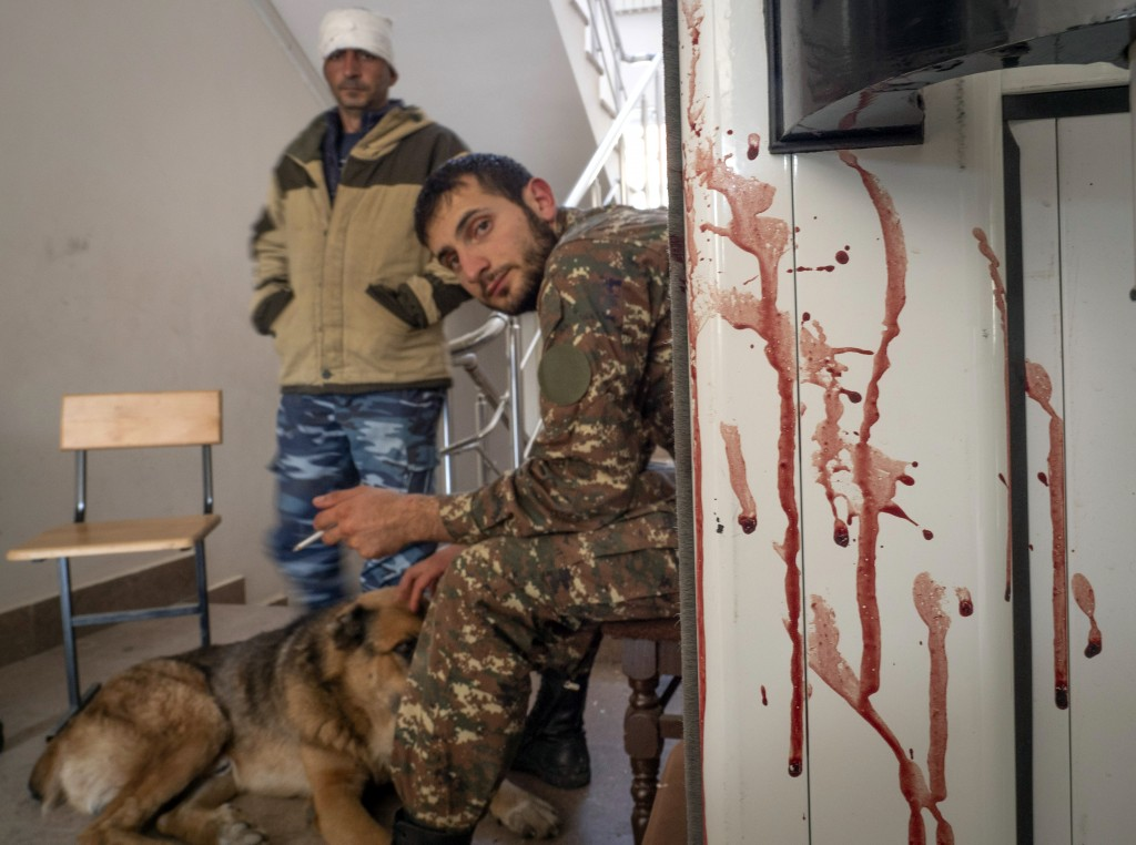 A bloody door is seen in a hospital damaged by shelling from Azerbaijan's artillery in the town of Martakert, the separatist region of Nagorno-Karabak...