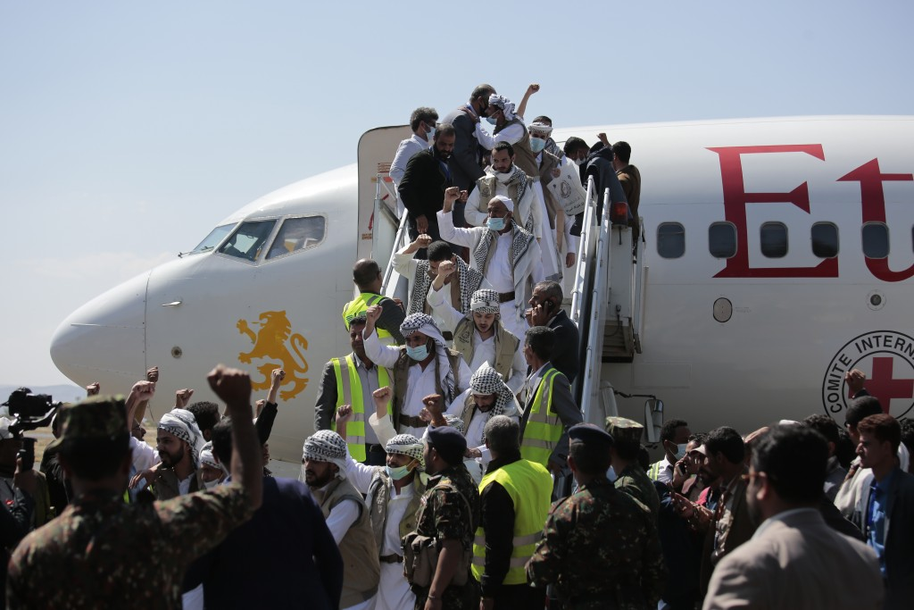 FILE - Yemeni prisoners chant slogans during their arrival after being released by the Saudi-led coalition in the airport of Sanaa, Yemen, Thursday, O...