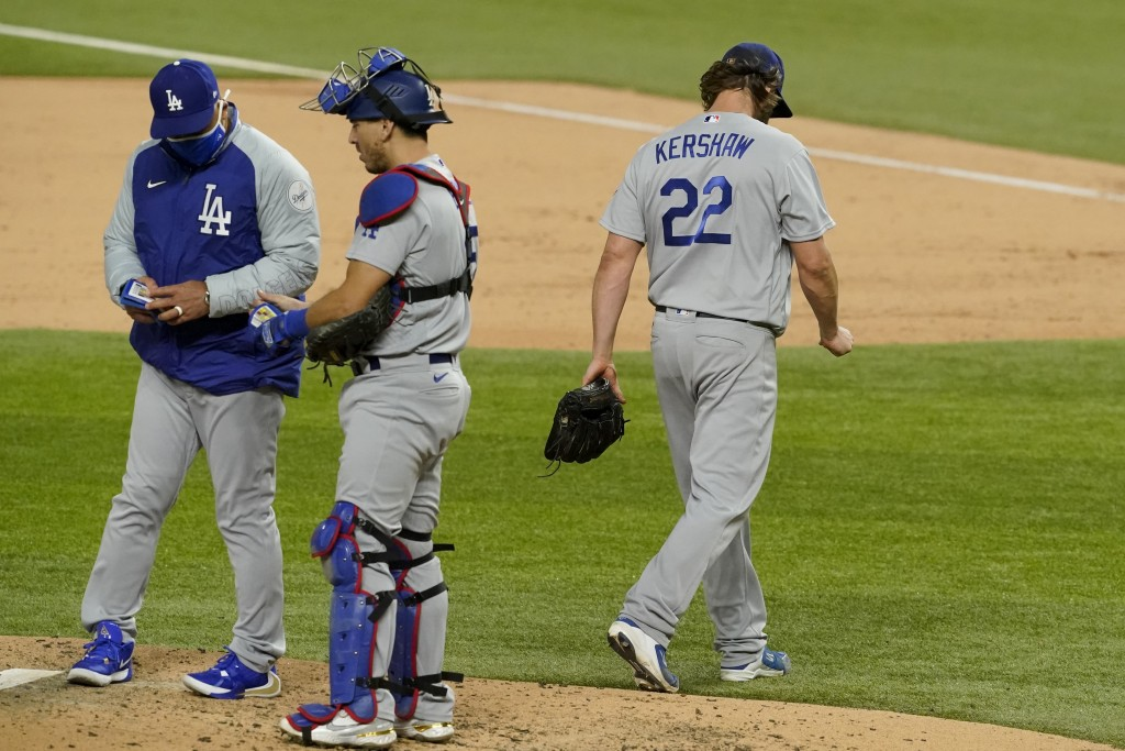 Los Angeles Dodgers starting pitcher Clayton Kershaw (22) leaves the game against the Atlanta Braves during the sixth inning in Game 4 of a baseball N...