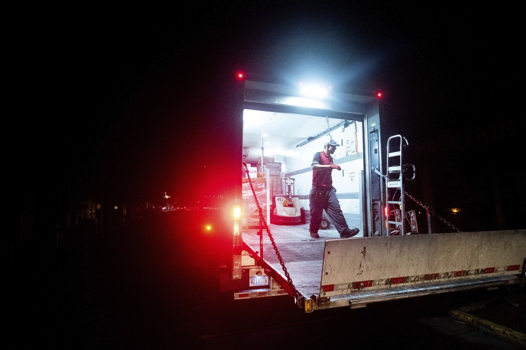 Ray Lopez delivers supplies to Mountain Mike's Pizza in the Montclair district of Oakland, Calif., where power is turned off, on Thursday, Oct. 15, 20...