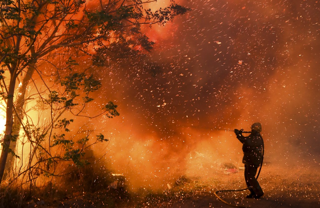 A firefighter battles flames in Cordoba, Argentina, Monday, Oct. 12, 2020. Wildfires have destroyed thousands of hectares in the Argentine province of...