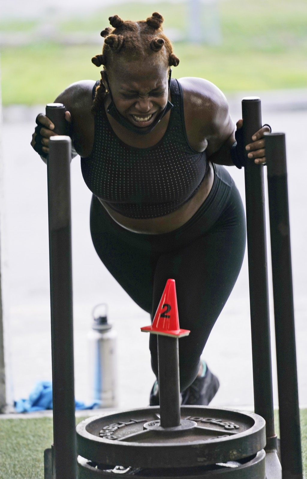 Suzie Leacock pushes a sled as she works out, Monday, Aug. 31, 2020, at Legacy Fit in the Wynwood Art District of Miami. As the vast majority of in-pe...