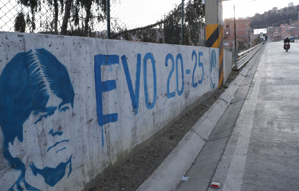 A graffiti of former Bolivian President Evo Morales adorns a wall prior to Sunday's elections, in La Paz, Bolivia, Thursday, Oct. 15, 2020. (AP Photo/...