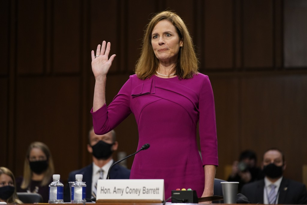 Supreme Court nominee Amy Coney Barrett is sworn in during a confirmation hearing before the Senate Judiciary Committee, Monday, Oct. 12, 2020, on Cap...