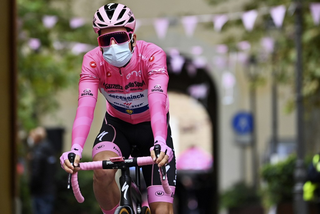 Portugal's Joao Almeida, wearing a mask to curb the spread of COVID-19 and the pink jersey of the race overall leader, gets ready to start the 13th st...