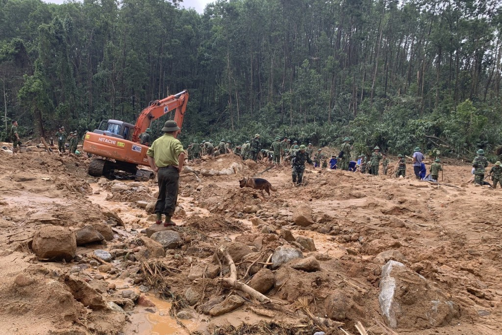 Rescue workers recover bodies of army officers buried in a landslide in centralVietnam on Oct. 15