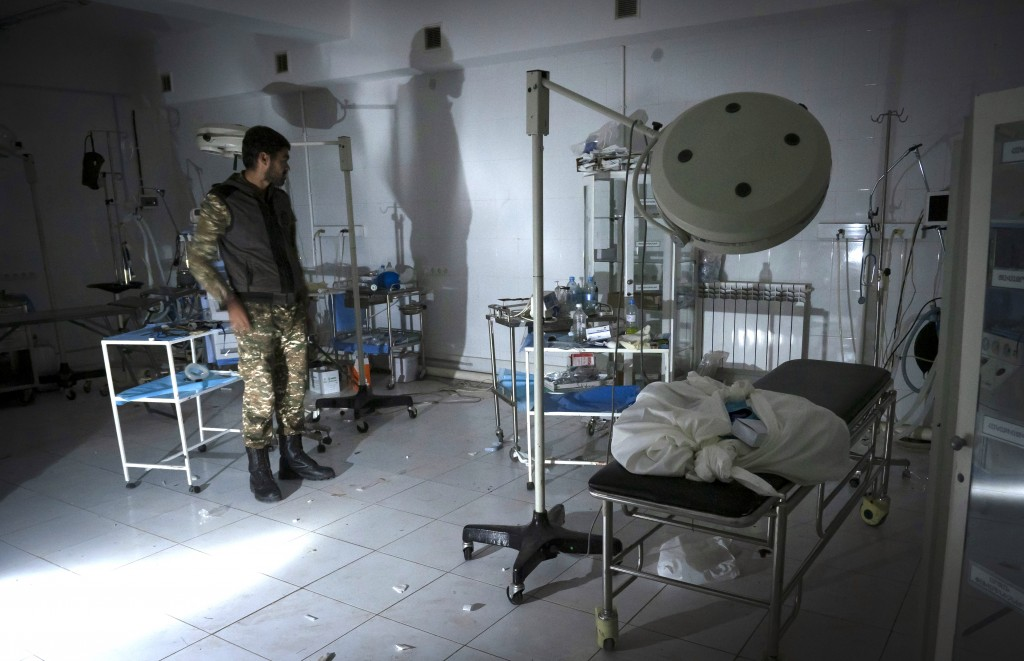 The doctor of a local hospital, damaged by shelling from Azerbaijan's artillery, stands in the surgery room of his hospital in the town of Martakert, ...