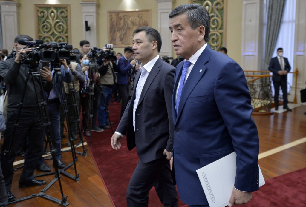 Kyrgyzstan's President Sooronbai Jeenbekov, right, and Prime Minister Sadyr Zhaparov arrive to attend an official ceremony of transfer of power at the...