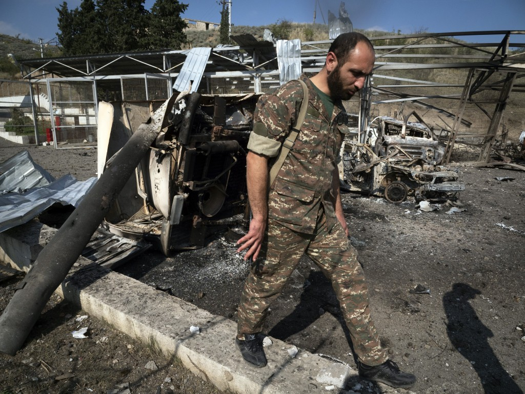 Gevorg, a doctor of a local hospital damaged by shelling from Azerbaijan's artillery, walks in the yard of his hospital in the town of Martakert, duri...