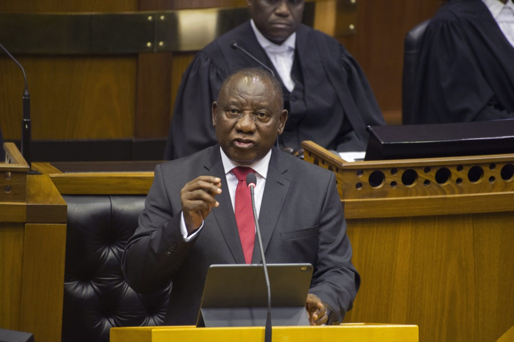 FILE — In this Thursday, June 20, 2019 file photo, South African President Cyril Ramaphosa delivers his State of the Nation Address in parliament in C...