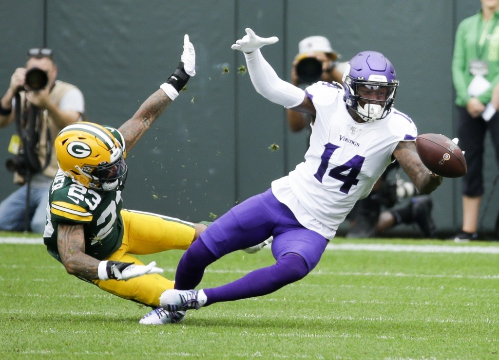 FILE - In this Sept. 15, 2019, file photo, Green Bay Packers' Jaire Alexander, left, breaks up a pass intended for Minnesota Vikings' Stefon Diggs dur...