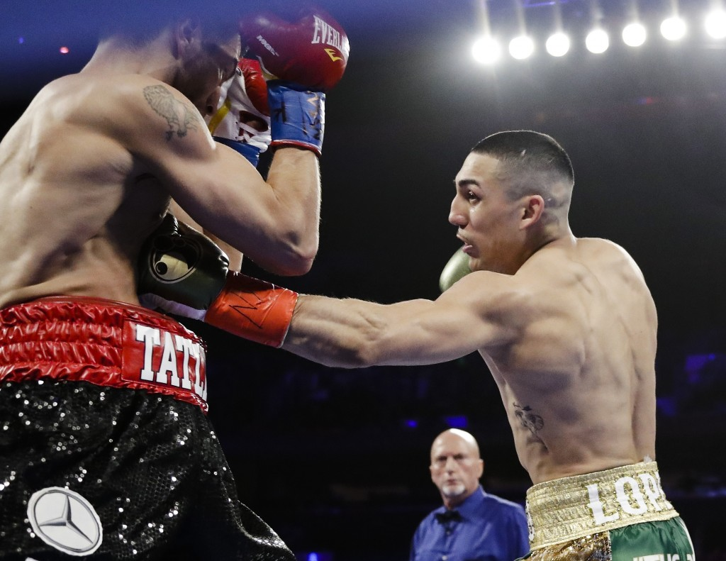 FILE - In this Saturday, April 20, 2019, file photo, Teofimo Lopez, right, punches Finland's Edis Tatli during the first round of a NABF lightweight c...
