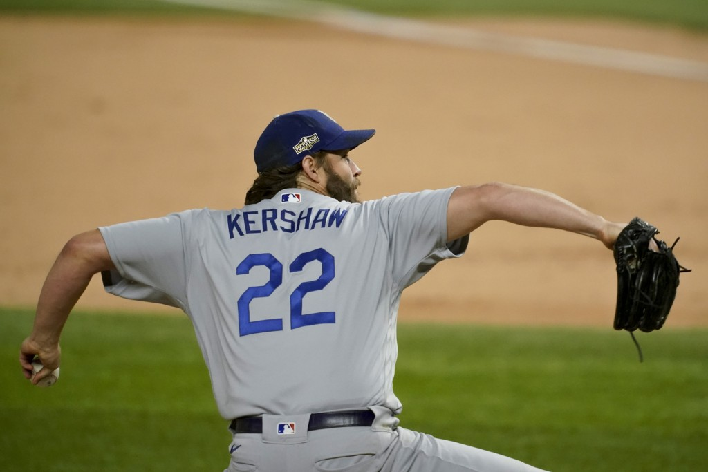 Los Angeles Dodgers starting pitcher Clayton Kershaw throws against the Atlanta Braves during the fifth inning in Game 4 of a baseball National League...