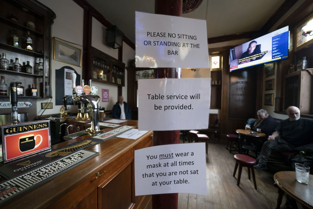 Signage showing anti-coronavirus guidance measures is displayed in the Dispensary pub in Liverpool, England, Monday Oct 12, 2020. As the first area in...
