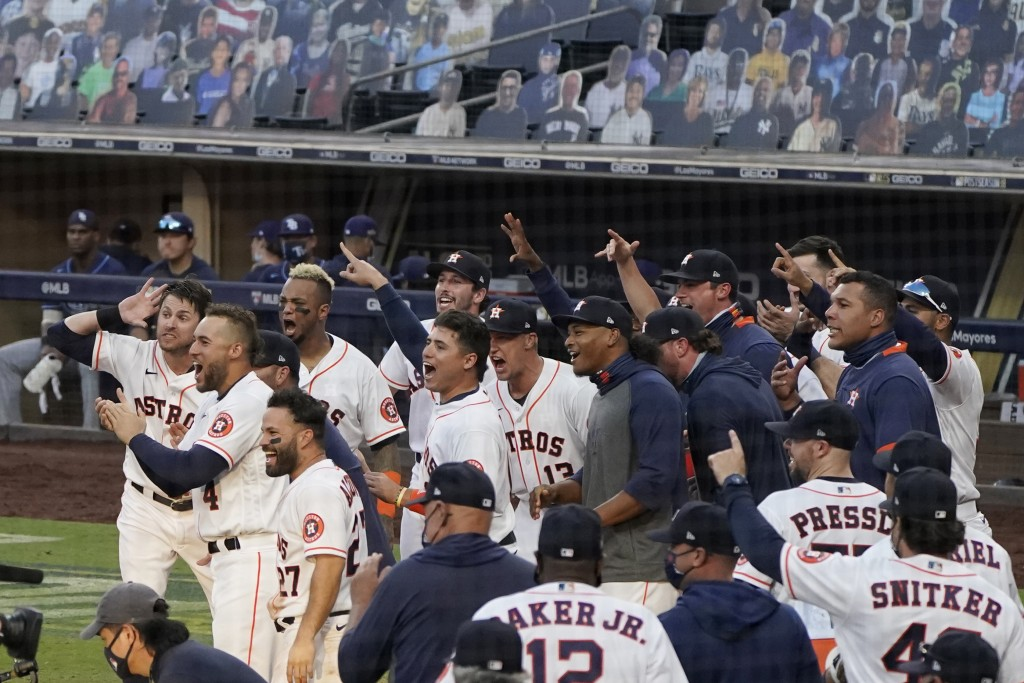 Players celebrate Houston Astros Carlos Correa's walk off home run during the ninth inning in Game 5 of a baseball American League Championship Series...