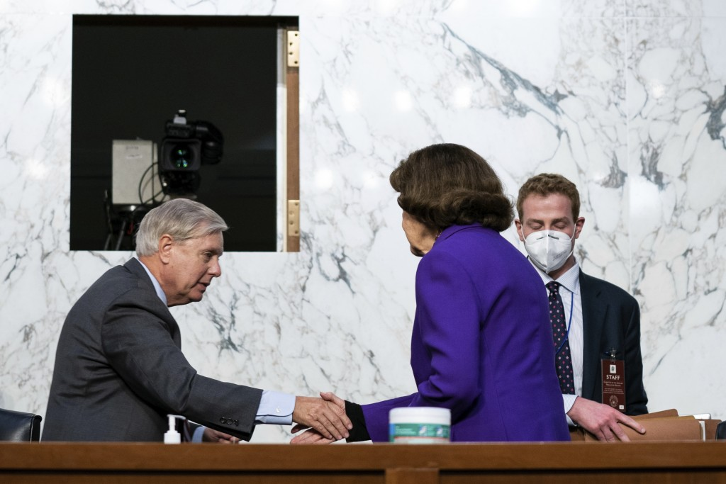 Sen. Lindsey Graham, R-S.C., shakes hands with Sen. Dianne Feinstein, D-Calif., following the fourth day of a confirmation hearing for Supreme Court n...