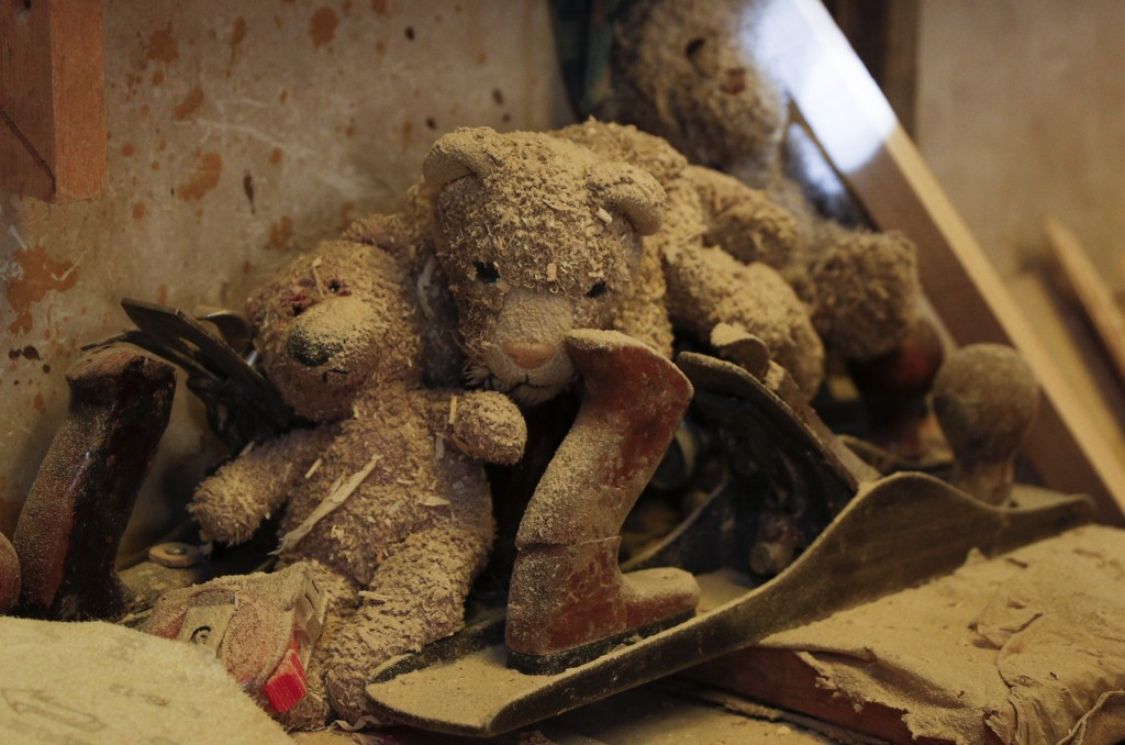 Teddy Bears covered in sawdust sit nex to tools at a family-run carpentry workshop in El Alto, Bolivia, Friday, Aug. 28, 2020. In Bolivia, the governm...