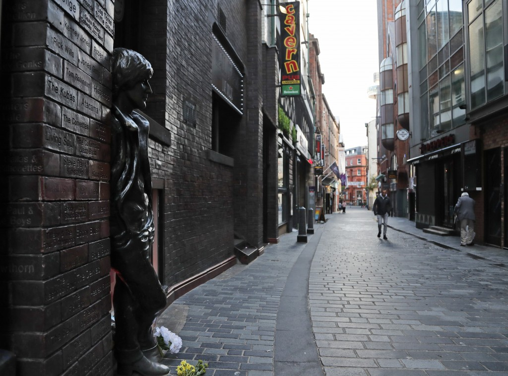 The Cavern Quarter is almost empty as new anti-coronavirus measures are set to come into force in Liverpool, England, Wednesday, Oct. 14, 2020. (AP Ph...