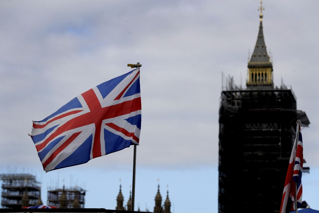The Union flag flies above a souvenir stand in front of Big Ben in London, Friday, Oct. 16, 2020. Britain's foreign minister says there are only narro...