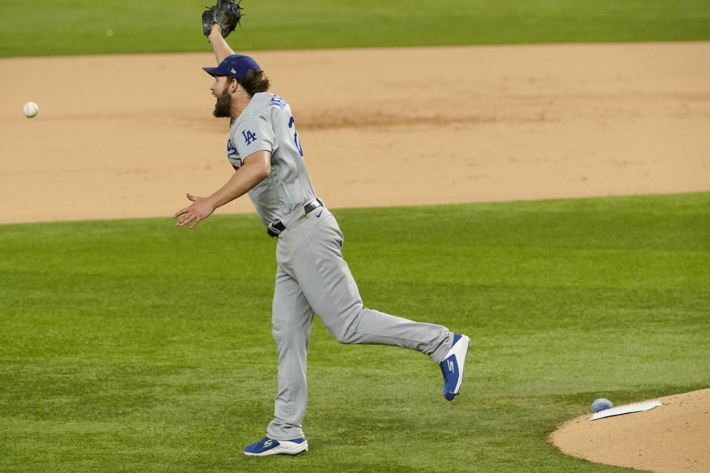 Los Angeles Dodgers starting pitcher Clayton Kershaw can't get a glove on a base hit by Atlanta Braves' Ronald Acuna Jr. during the sixth inning in Ga...