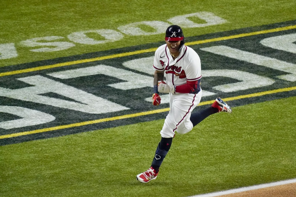 Atlanta Braves' Cristian Pache celebrates after a RBI-single single against the Los Angeles Dodgers during the second inning in Game 5 of a baseball N...
