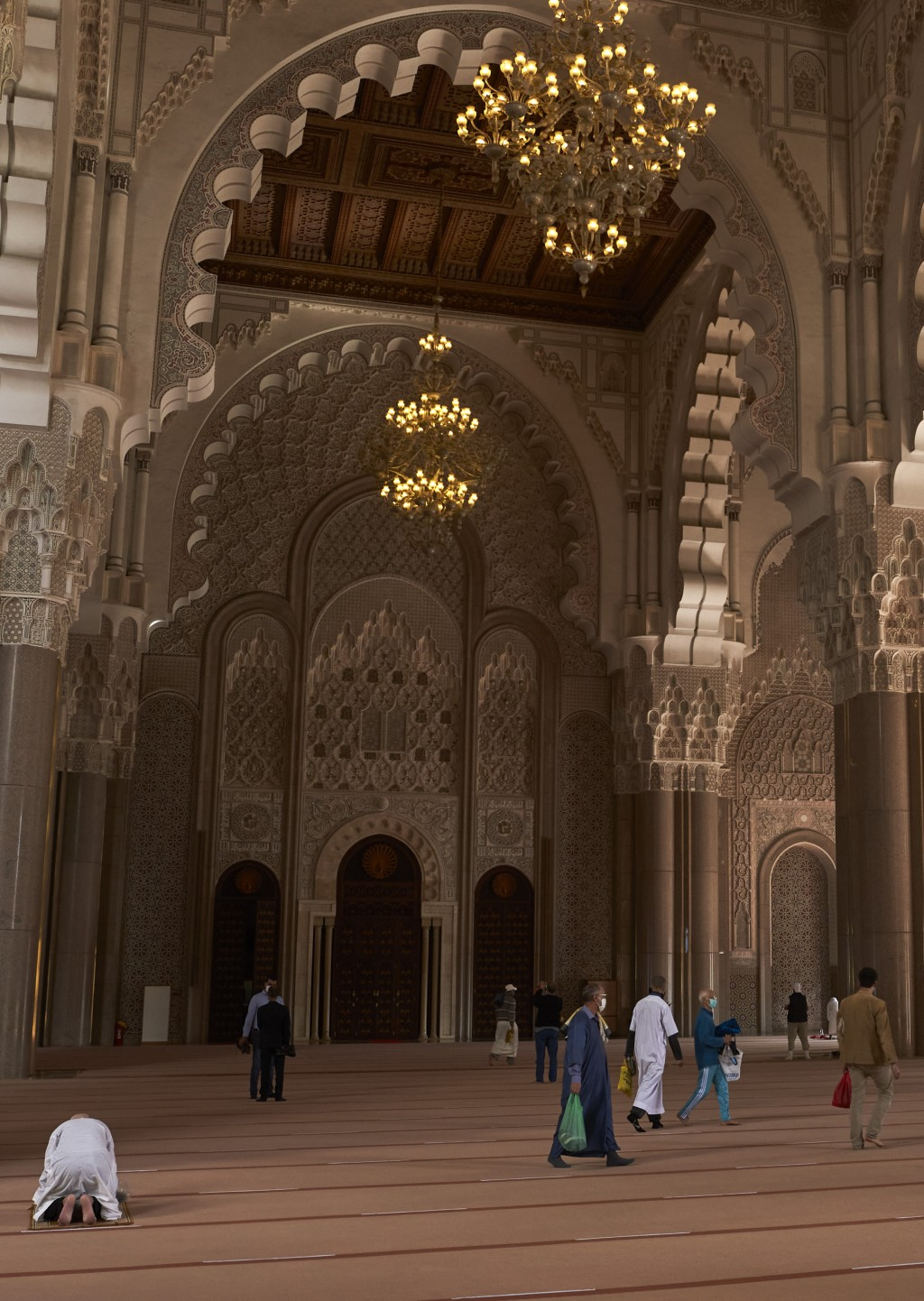 Moroccans wear face masks and pray respecting social distancing at the great Hassan II Mosque in Casablanca, Morocco, Friday,Oct. 16, 2020. In Morocco...