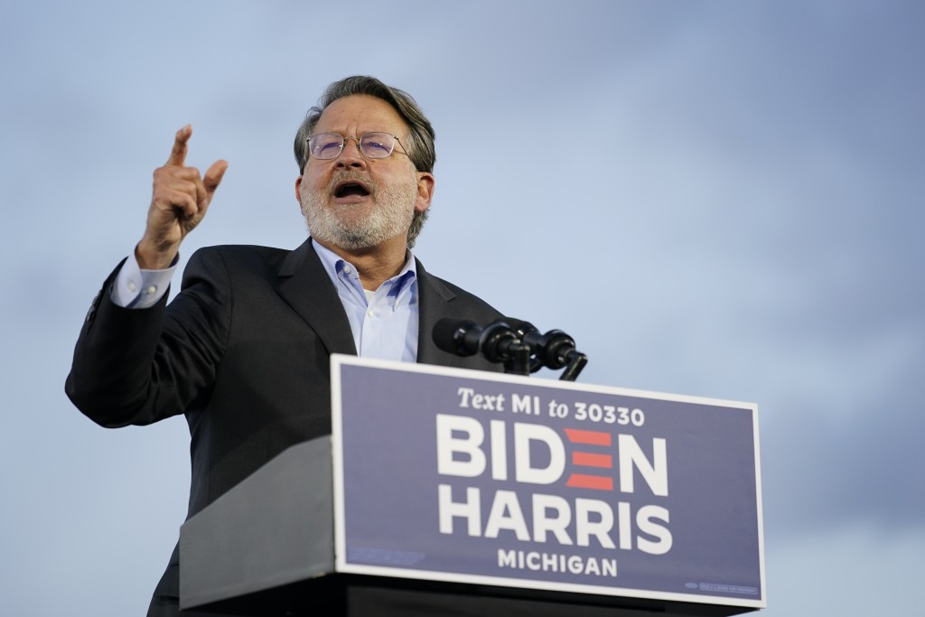 Sen. Gary Peters, D-Mich., speaks during an event for Democratic presidential candidate former Vice President Joe Biden at Michigan State Fairgrounds ...