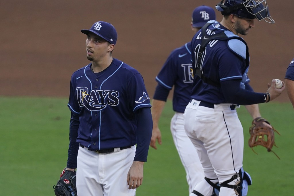 Tampa Bay Rays pitcher Blake Snell walks off the mound after being relieved during the fifth inning in Game 6 of a baseball American League Championsh...
