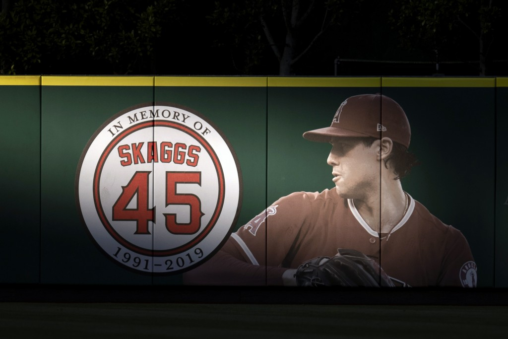 FILE - In this July 17, 2019, file photo, an image and logo for memorializing former Los Angeles Angels pitcher Tyler Skaggs is displayed on the outfi...
