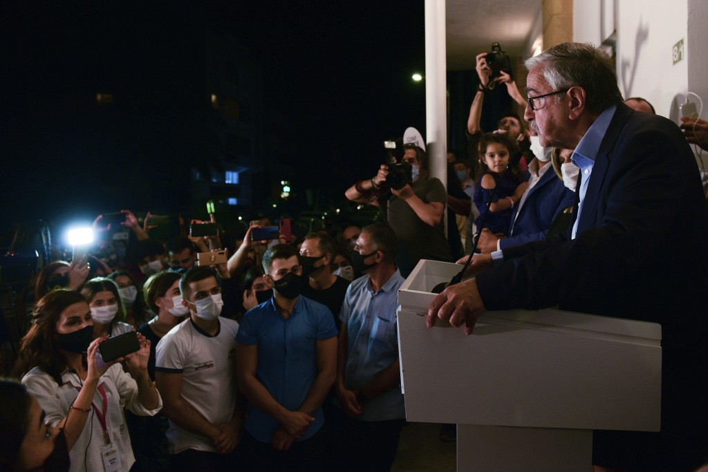In this photo taken on Sunday, Oct. 11, 2020, Turkish Cypriot leader and candidate Mustafa Akinci addresses to his supporters after reaching the secon...