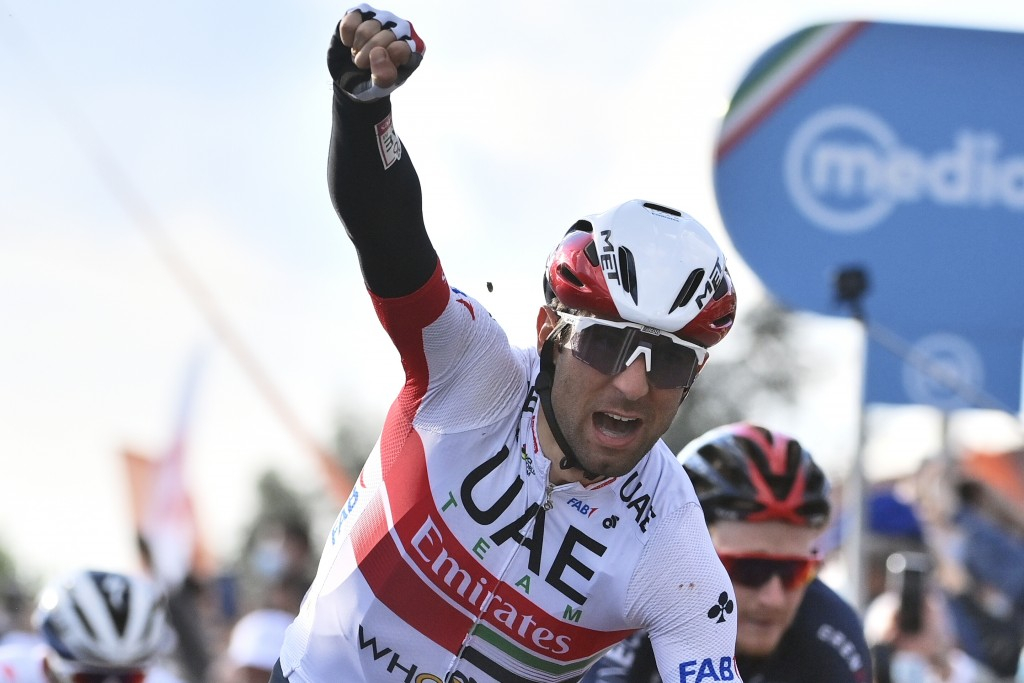Italy's Diego Ulissi celebrates as he crosses the finish line to win the 13th stage of the Giro d'Italia, tour of Italy cycling race, from Cervia to M...