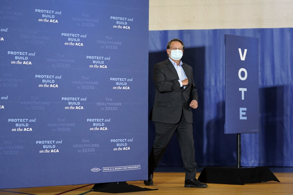 Sen. Gary Peters, D-Mich., arrives to speak during an event with Democratic presidential candidate former Vice President Joe Biden at Beech Woods Recr...