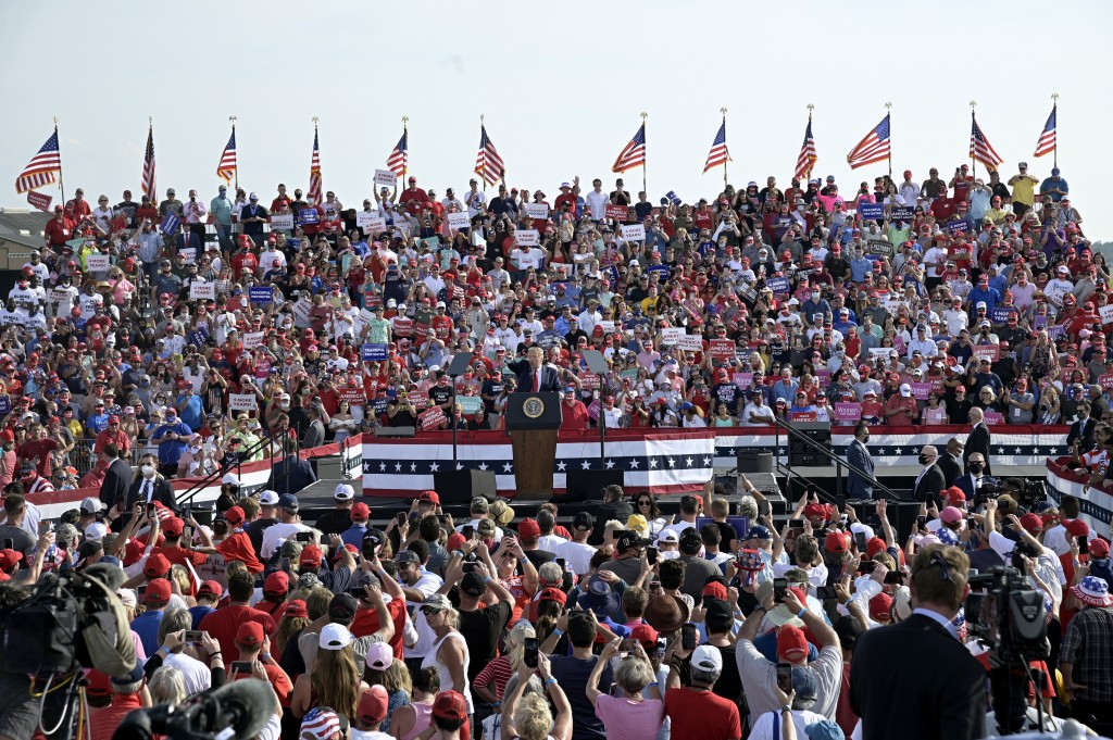 President Donald Trump addresses supporters during a campaign rally at the Ocala International Airport, Friday, Oct. 16, 2020, in Ocala, Fla. (AP Phot...