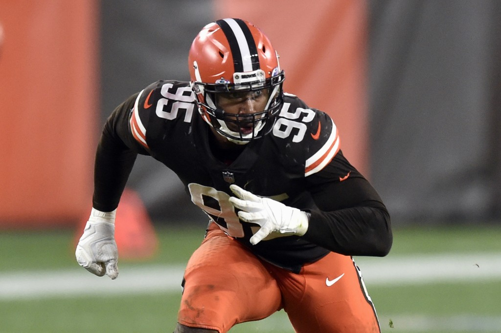 FILE - In this Sunday, Oct. 11, 2020, file photo, Cleveland Browns defensive end Myles Garrett (95) rushes the passer during an NFL football game agai...