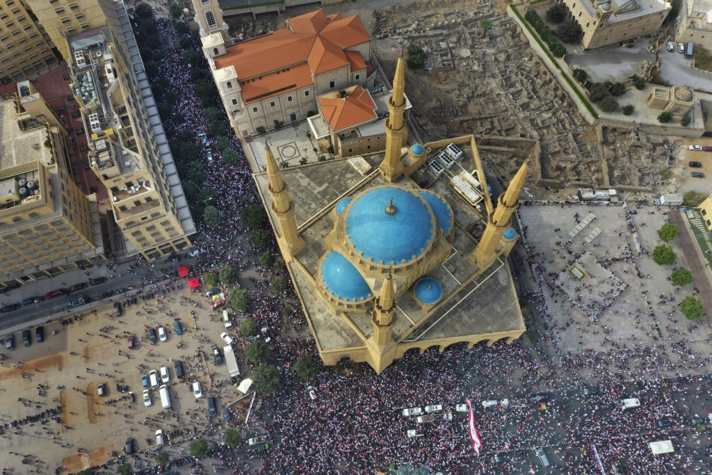 FILE - In this Sunday, Oct. 20, 2019 file photo, an aerial view shows anti-government protest, in downtown Beirut, Lebanon. A year ago, hundreds of th...