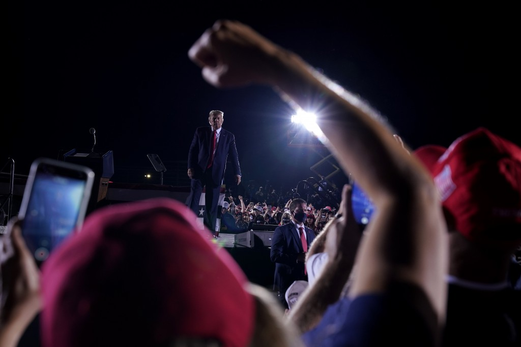 Supporters cheer as President Donald Trump leaves after speaking at a campaign rally at Middle Georgia Regional Airport, Friday, Oct. 16, 2020, in Mac...