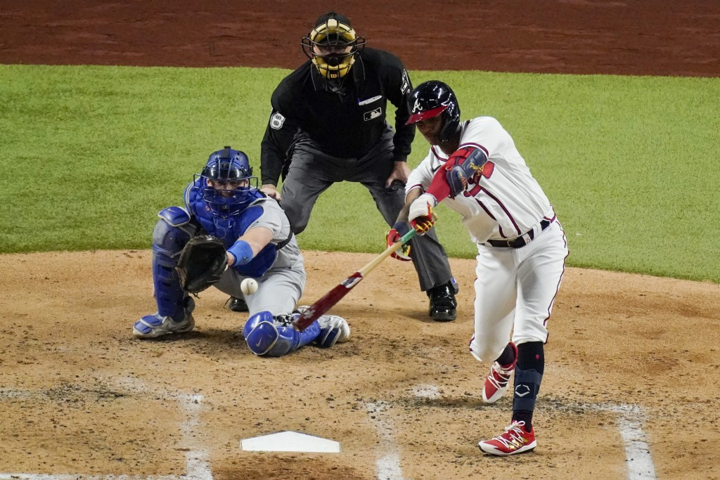 Atlanta Braves' Cristian Pache hits a RBI-single single against the Los Angeles Dodgers during the second inning in Game 5 of a baseball National Leag...